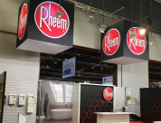 Peek Exhibition design & build trade display for Rheem NZ including overhead rigged fabric illuminated cube banners